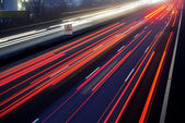 Light trail view at a busy highway — Stock fotografie