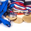 Gold and silver sport medals — Stock Photo #27567135