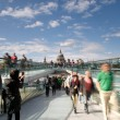 A tourist photographs St Paul's Cathedral from the London Millennium Footbridge, Bankside, London, UK — Stock Photo