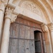 Stock Photo: Medieval arquitrave and frieze over church door, Siurana, Spain