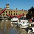 St Katherine Docks with boats and open drawbridge, London - Stock Photo