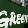 Greenpeace logo on their ship, the Rainbow Warrior III - Stock Photo