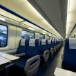 Inside of an empty passenger train car - Stock Photo