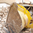 Stock Photo: Digger demolishing building, Spain