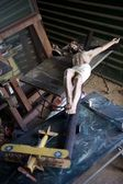 Jesus on the cross statuette relegated to a thrift store — Stock Photo