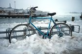 Bicycle parked and partially covered in snow and ice, Helsinki, Finland — Stock Photo