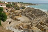 Roman ampitheatre with sea in background, Tarragona, Spain — Stock Photo