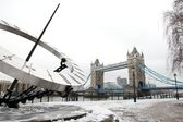 Tower Bridge and Tower Hill Dial in the snow, London, UK — Stock Photo