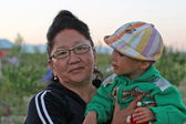 Kyrgyz Woman and Child, lake Issyk Kul region — Stock Photo