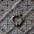Old door with ornament in stone wall in Royal Wawel Castle, Cracow, Poland - Stock Photo