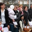 Blessing of food baskets at the church on easter (polish countryside). - Stock Photo