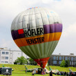 Hot air balloon inflating for launch - airshow cracow 2013 — Stock Photo