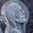 Face of Jesus, sculpture in cemetery — Stock Photo
