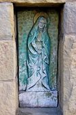 Holy Mary statue in old christian cemetery — ストック写真