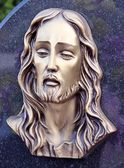 Face of Jesus, sculpture in cemetery — Stock fotografie