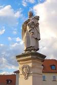 Statue of St. Philippus Benitius on Charles bridge, Prague — Stock Photo
