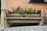 Stone carving bench in old town — Stock Photo
