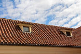 Red tiled roof with garret windows — Stock Photo