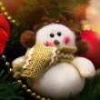 Funny snowman decoration on Christmas tree background — Stockfoto