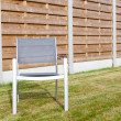 Stock Photo: Wooden fence whit chair