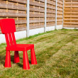 Wooden fence whit chair — Stock Photo