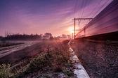 Sunrise whit train — Stock Photo