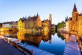 In Brugges at sunset during the blue hour, you see the refection of the building and the tower — Stock Photo