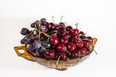 Fruit bowl with cherries and grapes — Stock Photo