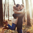 Sensual outdoor portrait of young couple in love — Stock Photo #23099236