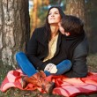 Couple sitting on the ground in park. — Stock Photo