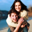 Young couple on the beach. — Stock Photo #23099922