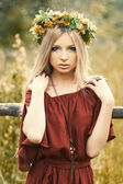 Girl with flowers on her head — Stock Photo