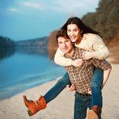 Couple having fun on board of the river. — Stock Photo