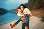 Couple having fun on board of the river. — Stock Photo