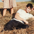 Young boy lying in hay. — Stock Photo #23100858