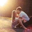 Couple kissing on the road — Stock Photo #23100894