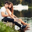 Couple having fun on the river — Stock fotografie