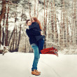 Young couple having fun outdoor in winter — Stock Photo