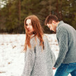 Couple walking in cold field — Stock Photo