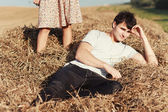 Young boy lying in hay. — Stock Photo