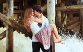 Couple kissing near waterfall — Stock Photo