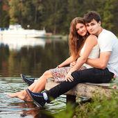 Couple having fun on the river — Stock Photo