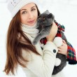 Beautiful woman with cat in winter — Stock Photo #23339928