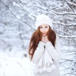 Girl in the winter forest. — Stock Photo #23340042