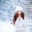 Girl in the winter forest. — Stock Photo #23340048