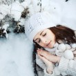 Girl sleeping in the snow — Stock Photo #23340078