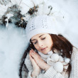 Girl sleeping in the snow — Stock Photo #23340080