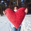 Girl  in park with big red heart. — Stock Photo