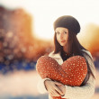 Girl  in park with big red heart. — Stockfoto