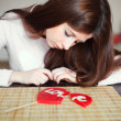 Woman with broken heart lollipop - Stock Photo